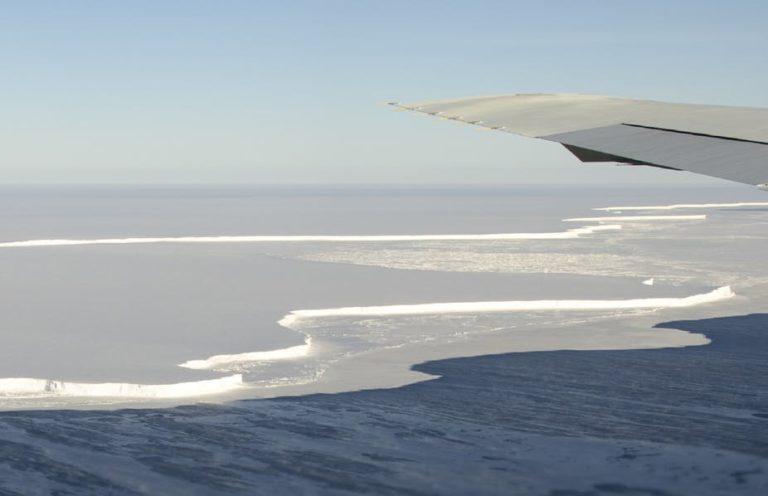Photo of arctic ice shelf and surrounding ocean