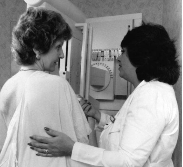 Phtograph of woman having a mammograms